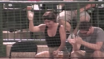 Fan catches foul ball in her beer then skulls it
