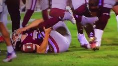 American Football Quarterback gets ankle twisted almost 180 degrees in gruesome tackle