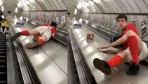 Soccer player sliding down escalator ends very badly