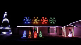 "Check out these awesome house Christmas Lights with Darude ""Sandstorm"" soundtrack"